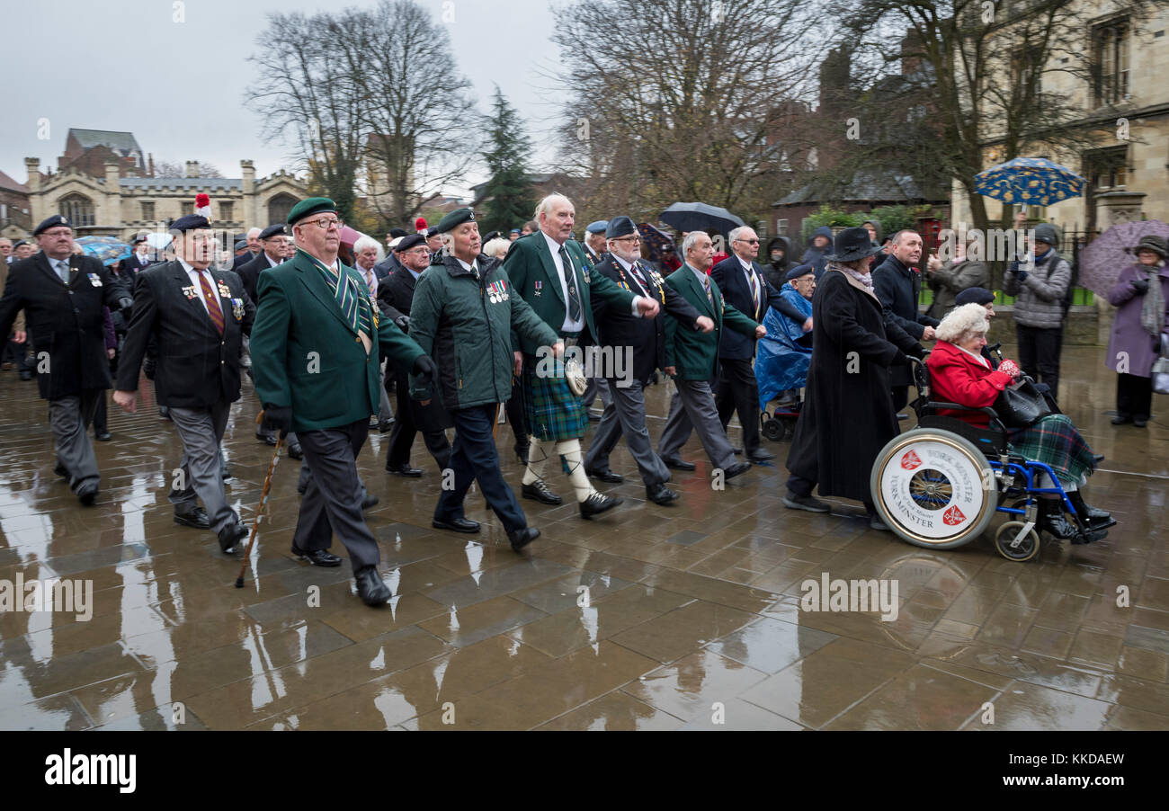 British veterans parade in rain outside York Minster commemorating 50th anniversary of British withdrawal from Aden - Stock Image