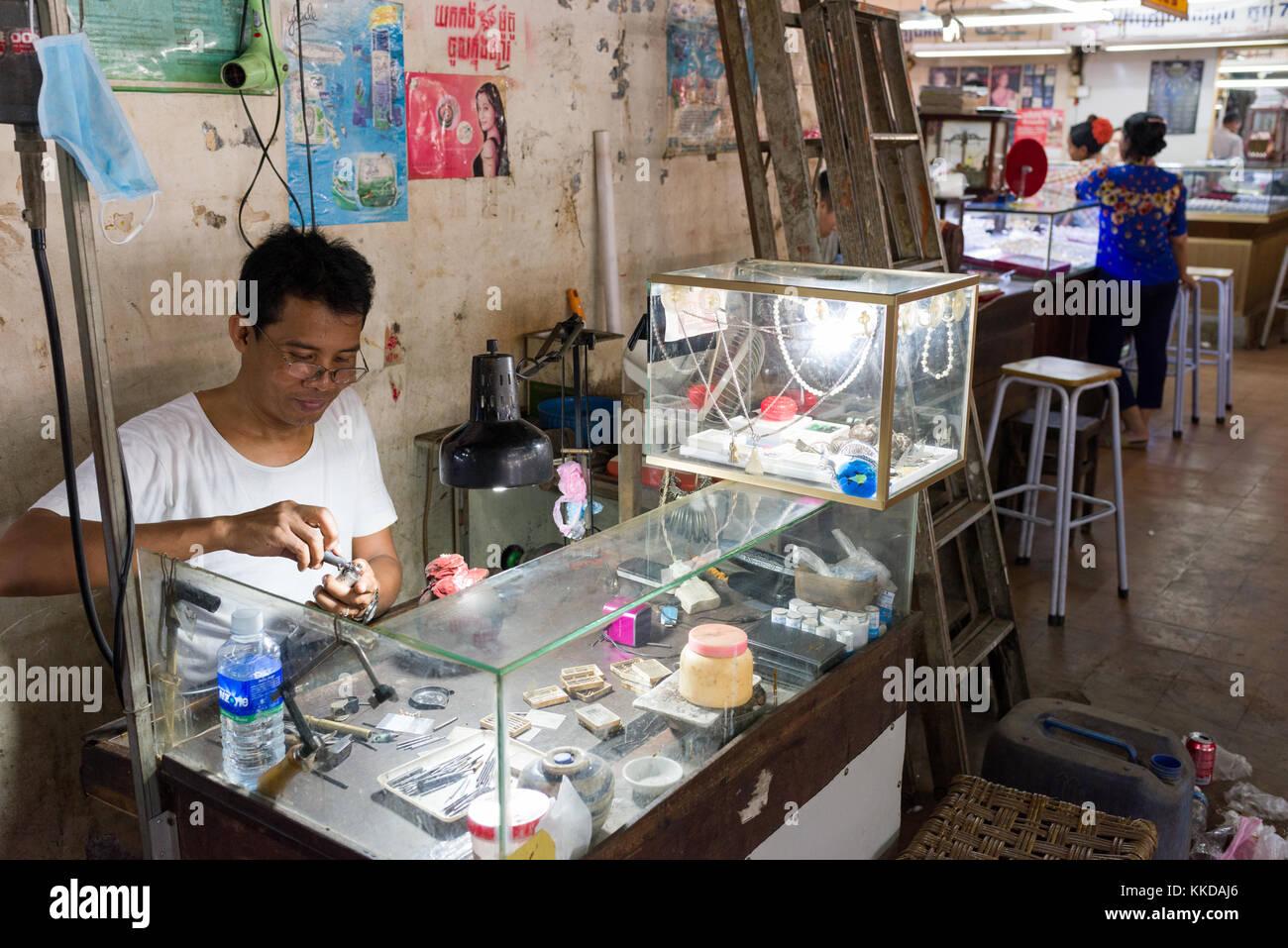 A jeweller at work in  Phsar Nath Market, Battambang, Cambodia - Stock Image