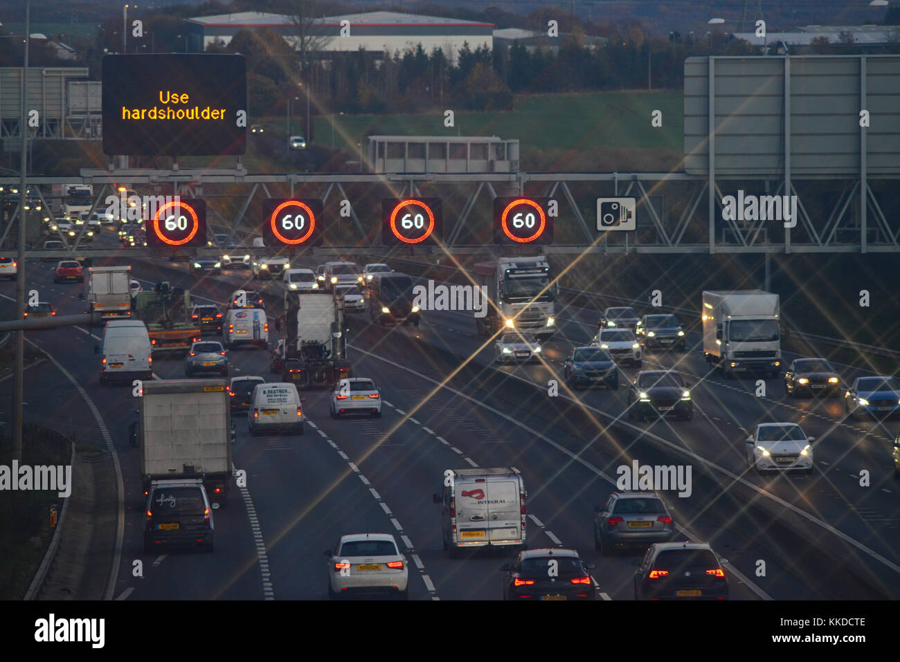 reduced speed limit and speed camera warning signs and speed on the m62 motorway leeds at dusk yorkshire united - Stock Image