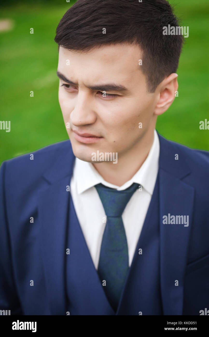 thoughtfull groom in the nature - Stock Image