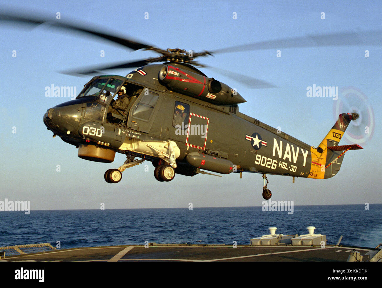 A left front view of a Helicopter Light Anti-submarine Squadron 30 (HSL-30) SH-2F Sea Sprite helicopter preparing - Stock Image