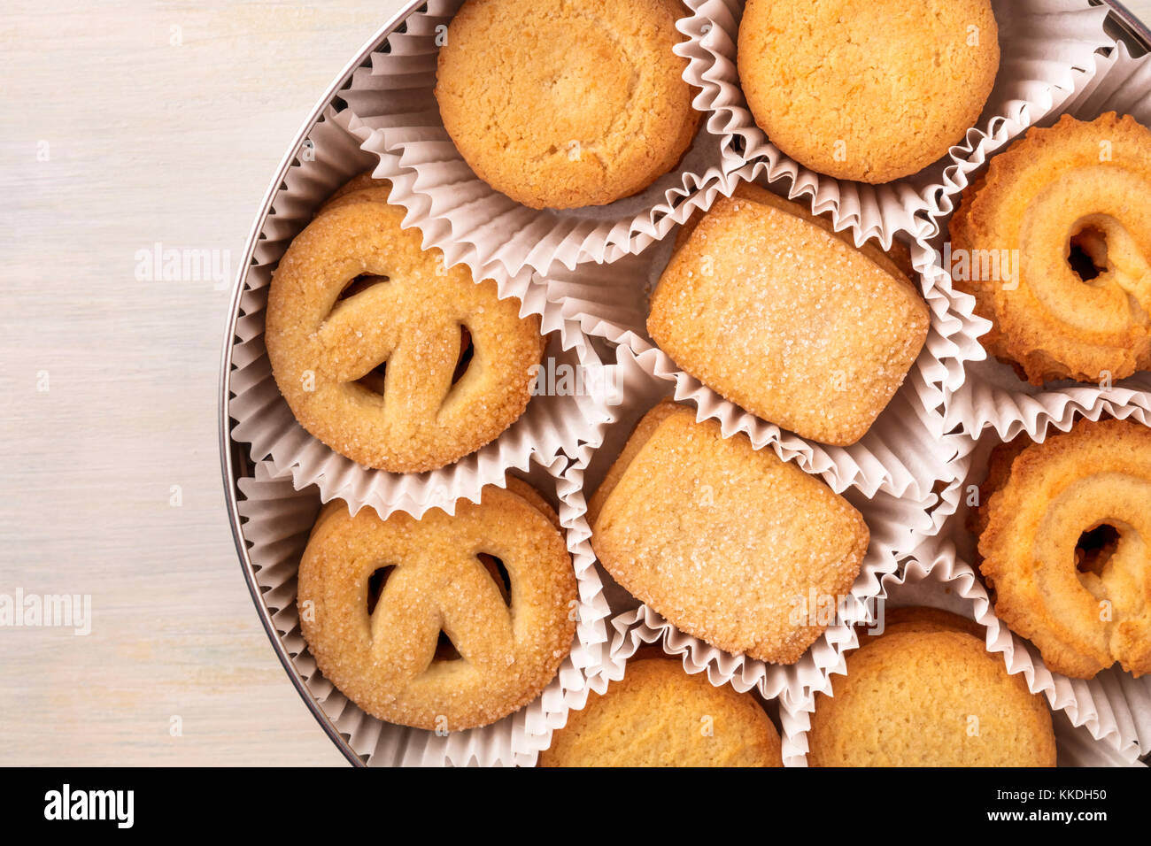 Closeup of Danish butter cookies in tin with copyspace - Stock Image