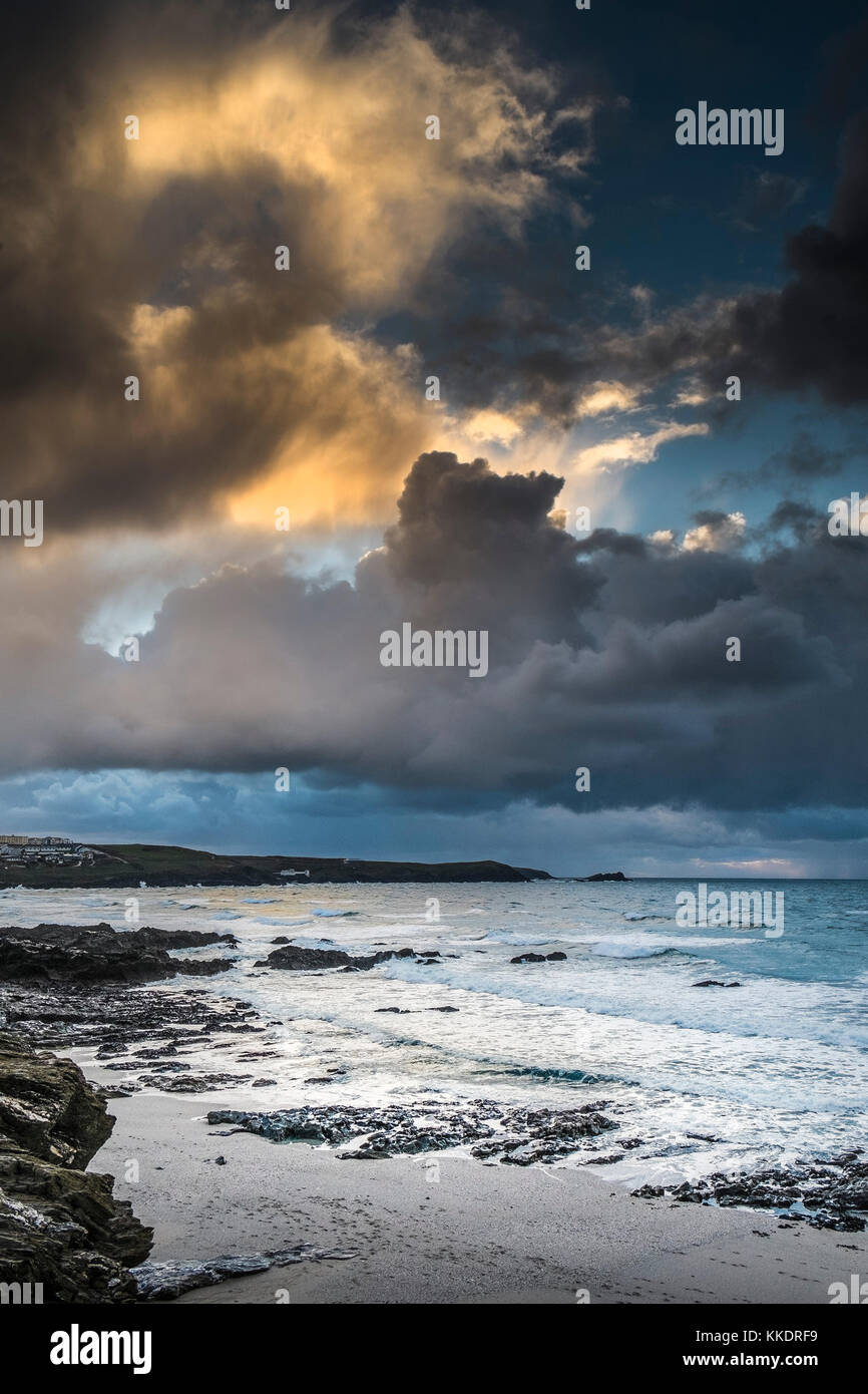 UK weather - as the sun sets ominous heavy rain clouds build over East Pentire Headland on the North Cornwall - Stock Image