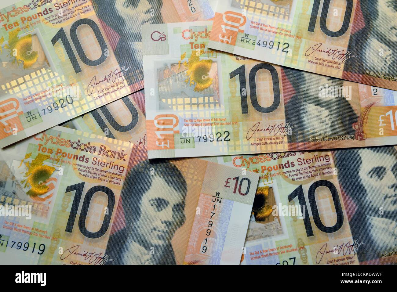 A pile of Clydesdale Bank, Scottish, plastic, ten pound notes with the face of poet - Stock Image