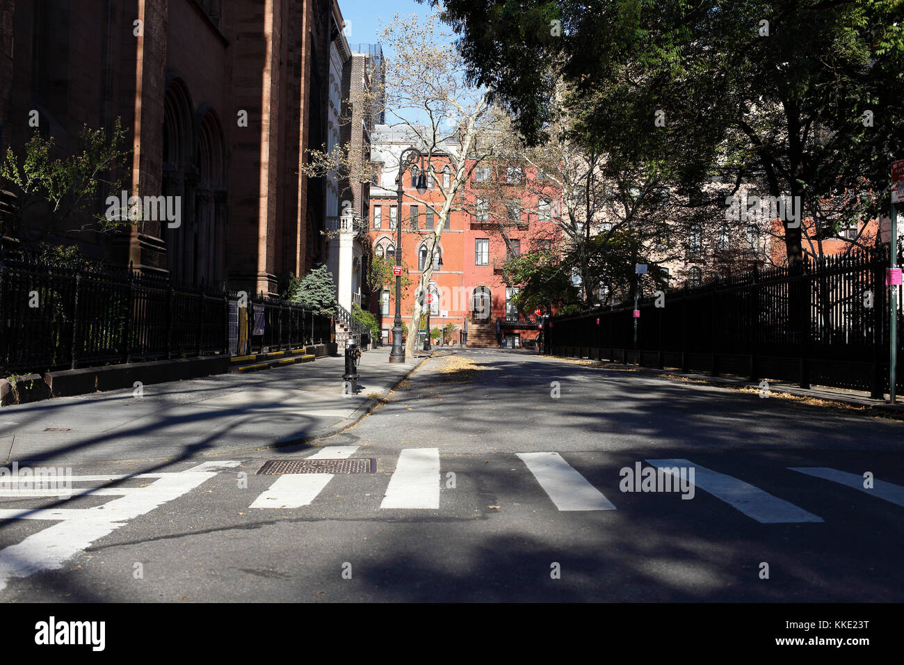 Empty street and crosswalk at Stuyvesant Square Park in New York City - Stock Image