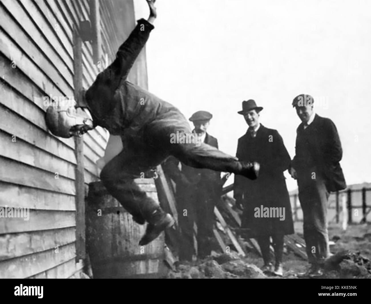 WARREN SAFETY HELMET. William Warren gives a dramatic demonstration of his patented pilot safety helmet in 1912Stock Photo