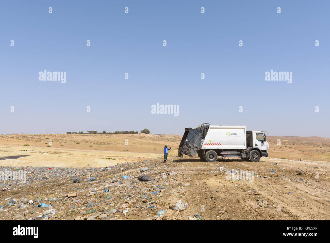 Truck dumping domestic garbage on a landfill site - Stock Image