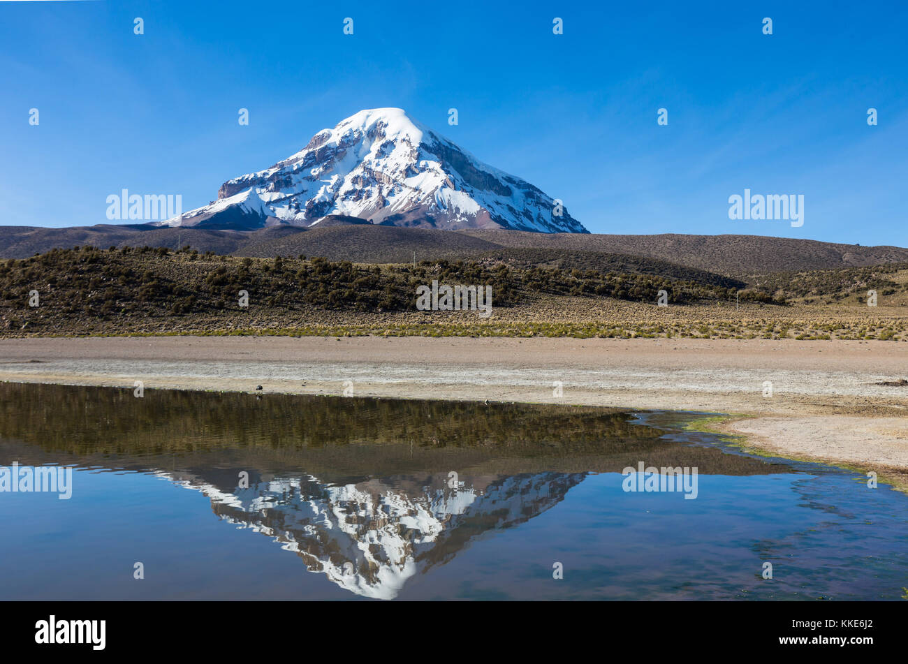 Sajama volcano and lake Huayñacota, in the Natural Park of Sajama. Bolivia - Stock Image
