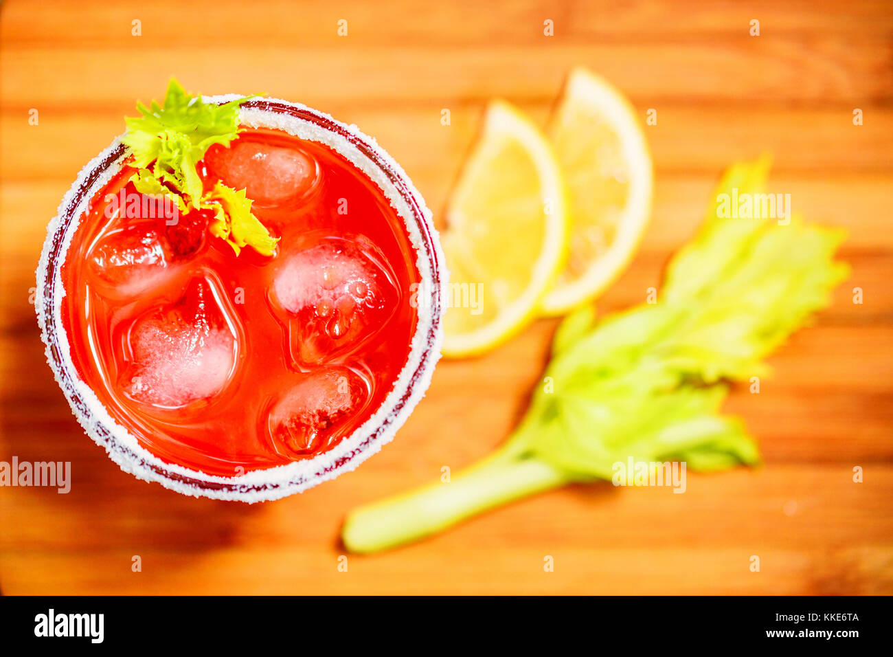 Bloody Mary alcoholic drink with lemon and celery - Stock Image