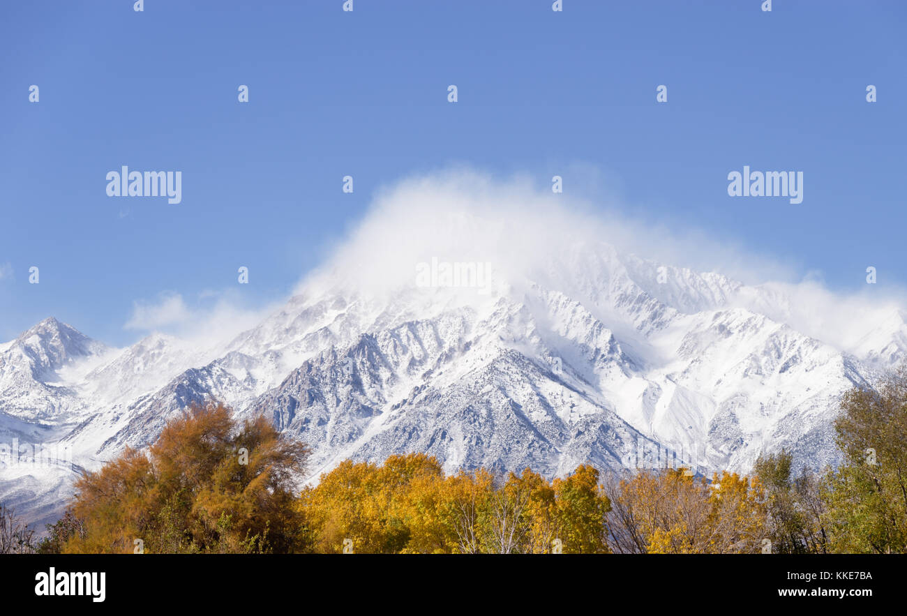 clouds rise to reveal Mount Tom with fresh snow - Stock Image