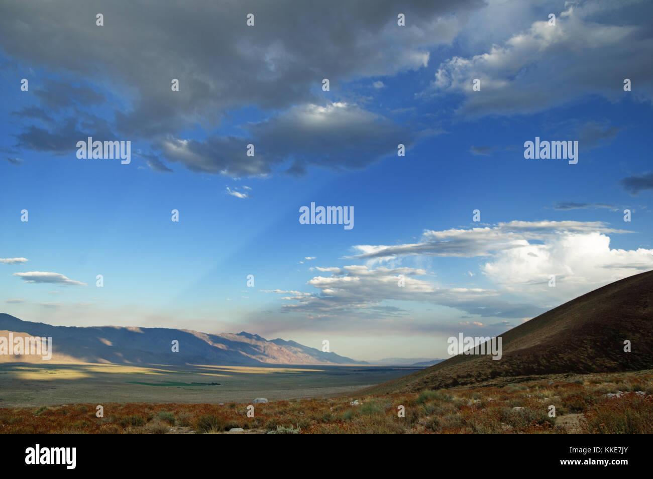 sunrays stream across the Owens Valley - Stock Image