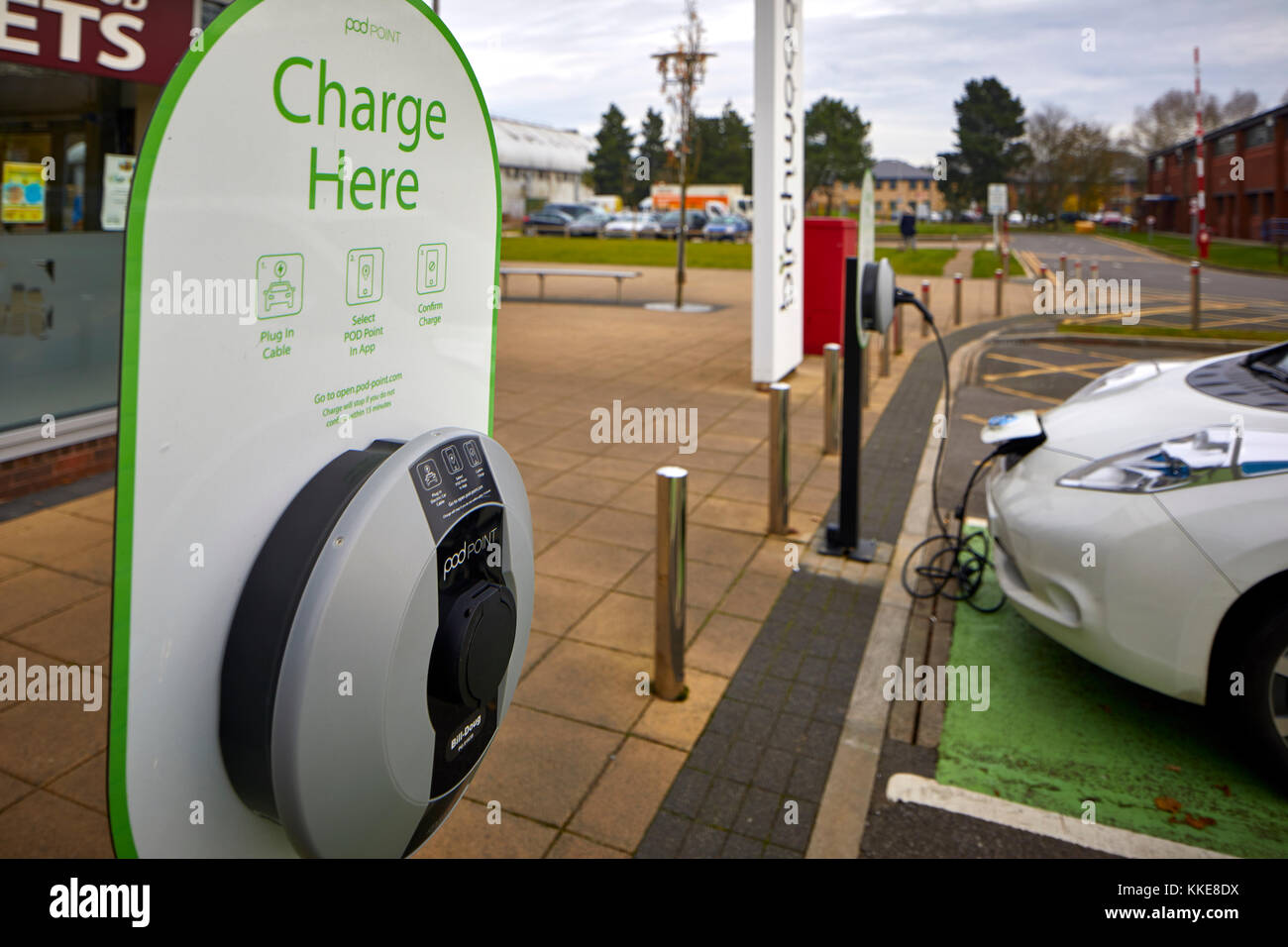 Burtonwood shopping centre in Warrington, an electric Nissan Leaf car parked in a dedicated parking bay for recharging - Stock Image