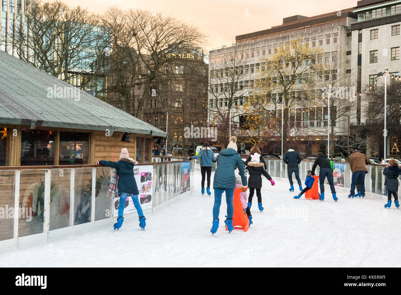 Edinburgh Christmas 2017 ice skating in St Andrew Square with Jenners store in the background, Edinburgh, Scotland, - Stock Image