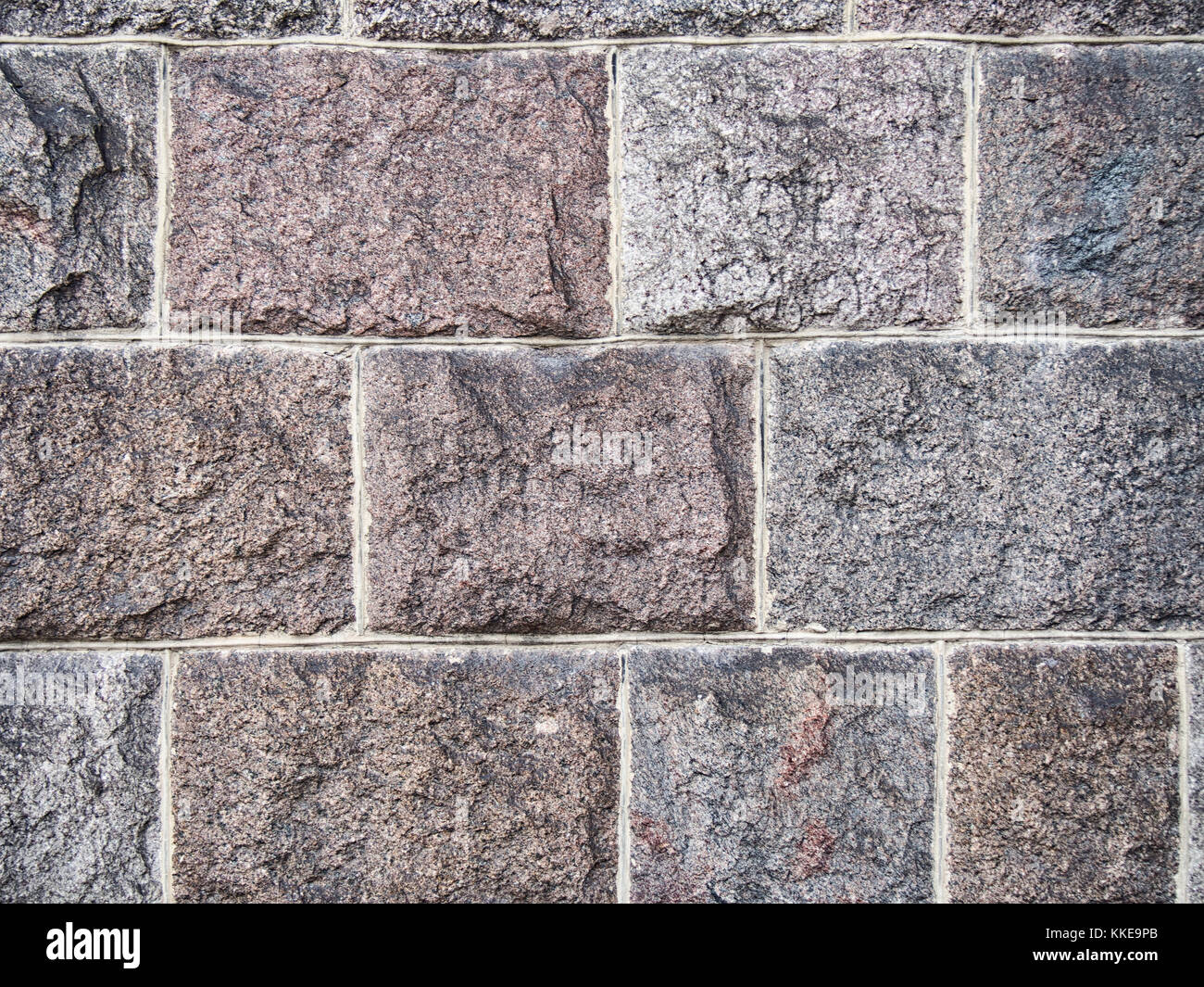 Granite masonry wall background - Stock Image