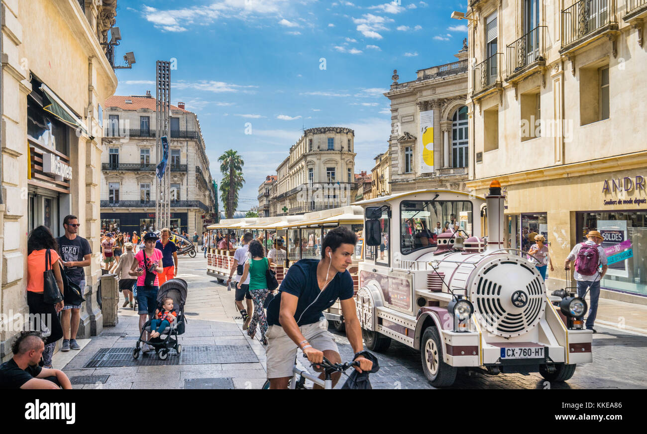 France, Hérault department, Montpellier, Le Petit Train loaded with sightseers turns into Rue de la Loge from - Stock Image