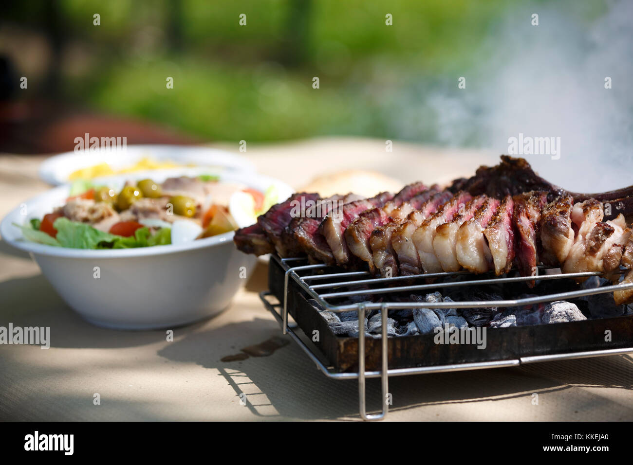 Steak with salad and fries. - Stock Image