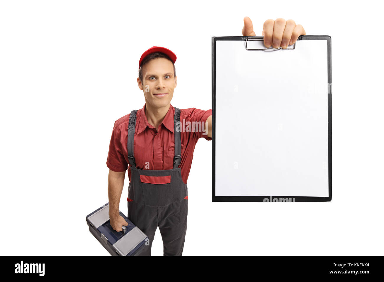 Serviceman showing a clipboard isolated on white background - Stock Image