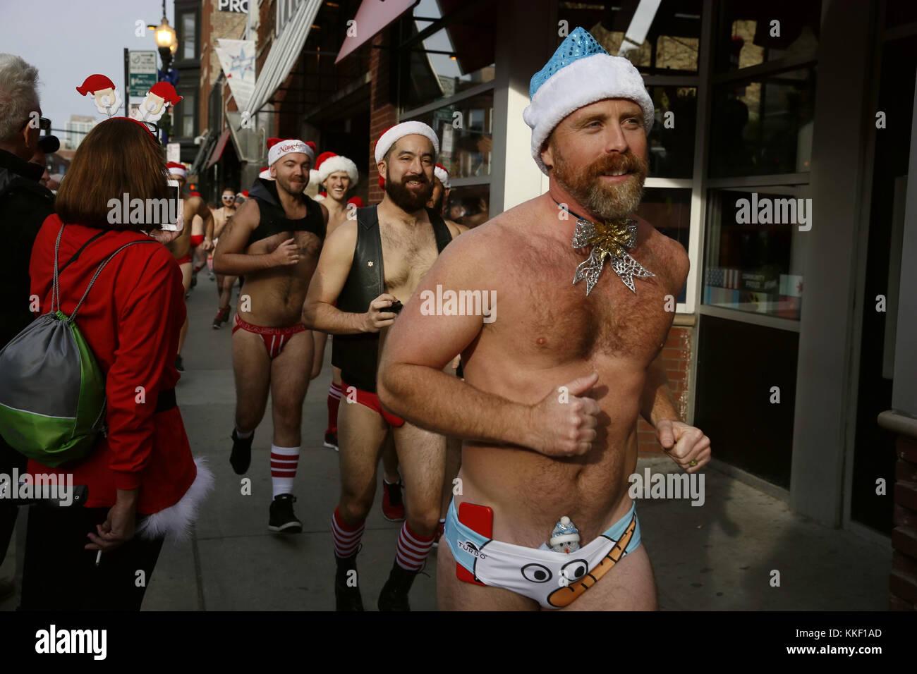 Chicago, USA. 2nd Dec, 2017. Participants wearing Santa Claus hats take part in the 2017 Chicago Santa Speedo Run Stock Photo
