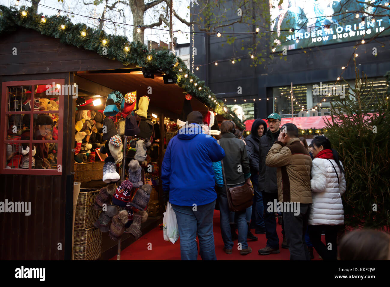 London, UK. 3rd Dec, 2017. People visit the Christmas Market in Leicester Square despite the dull and dismal weather Stock Photo