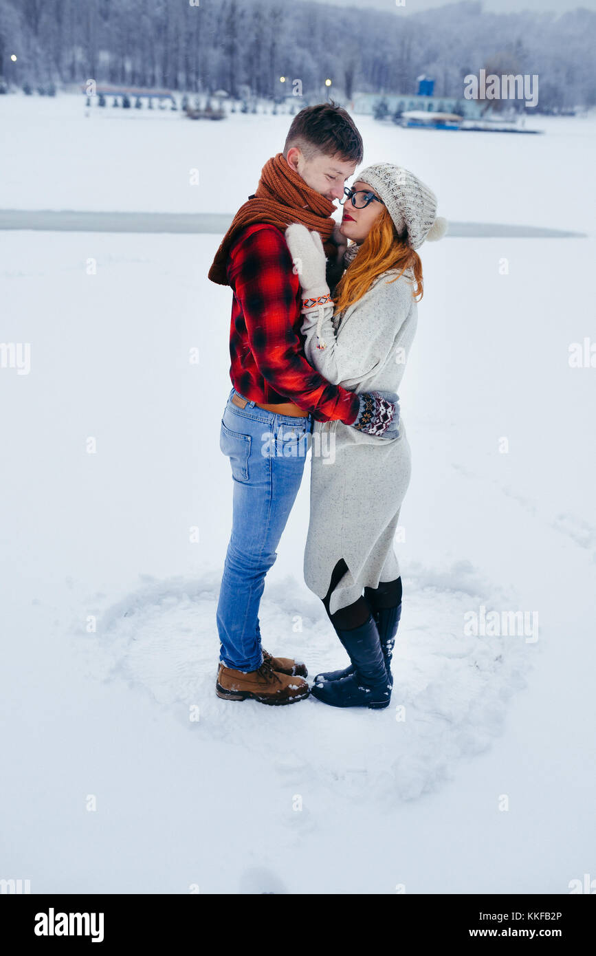 Couple Hugging Smiling Winter Snowy Countryside Full Length Vertical Fairytale Lovely Outdoor Portrait Timespending - Stock Image