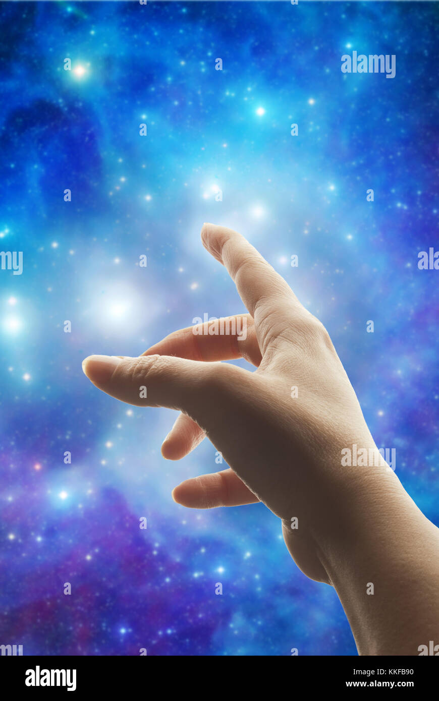 female hand pointing the finger to the stars - Stock Image