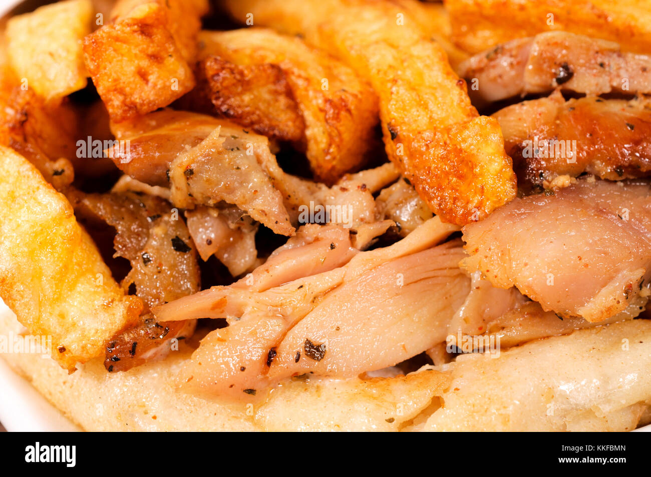 French fries and chicken meat - Stock Image