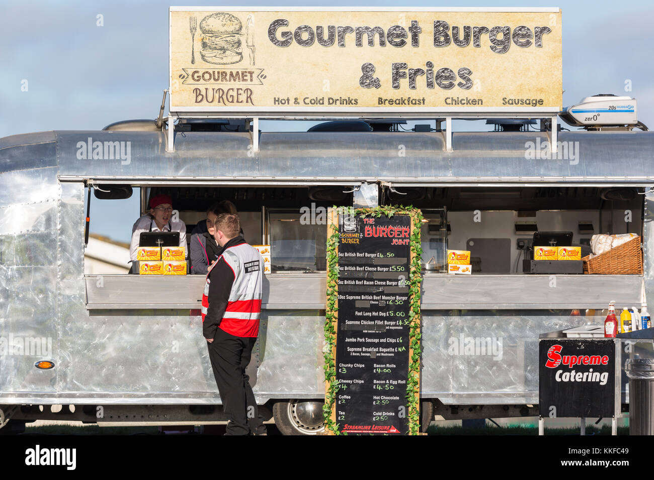 d31a5a4aa9 Mobile burger van   caravan with customer ordering food - Stock Image