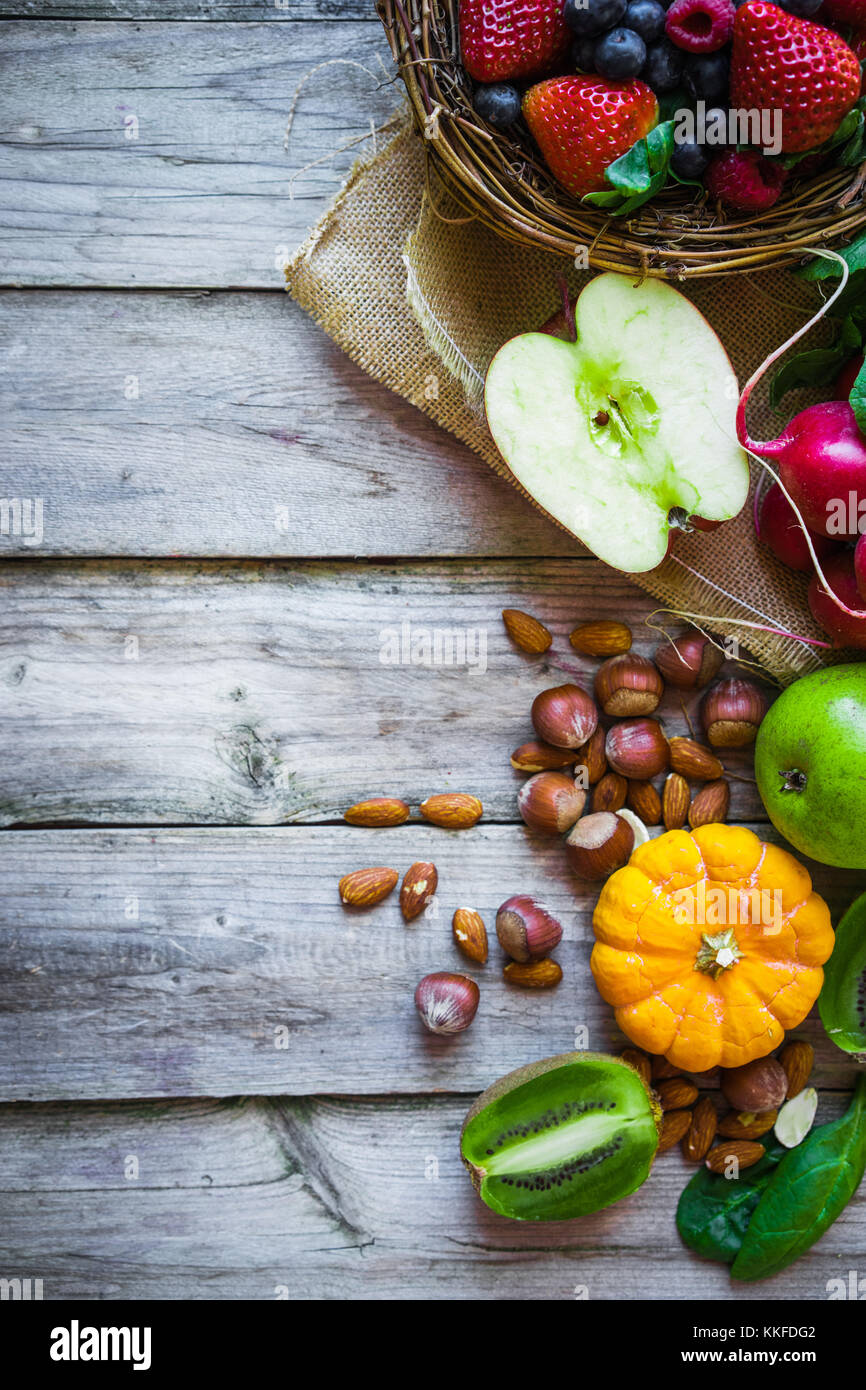 Fruits and vegetables on rustic background - Stock Image