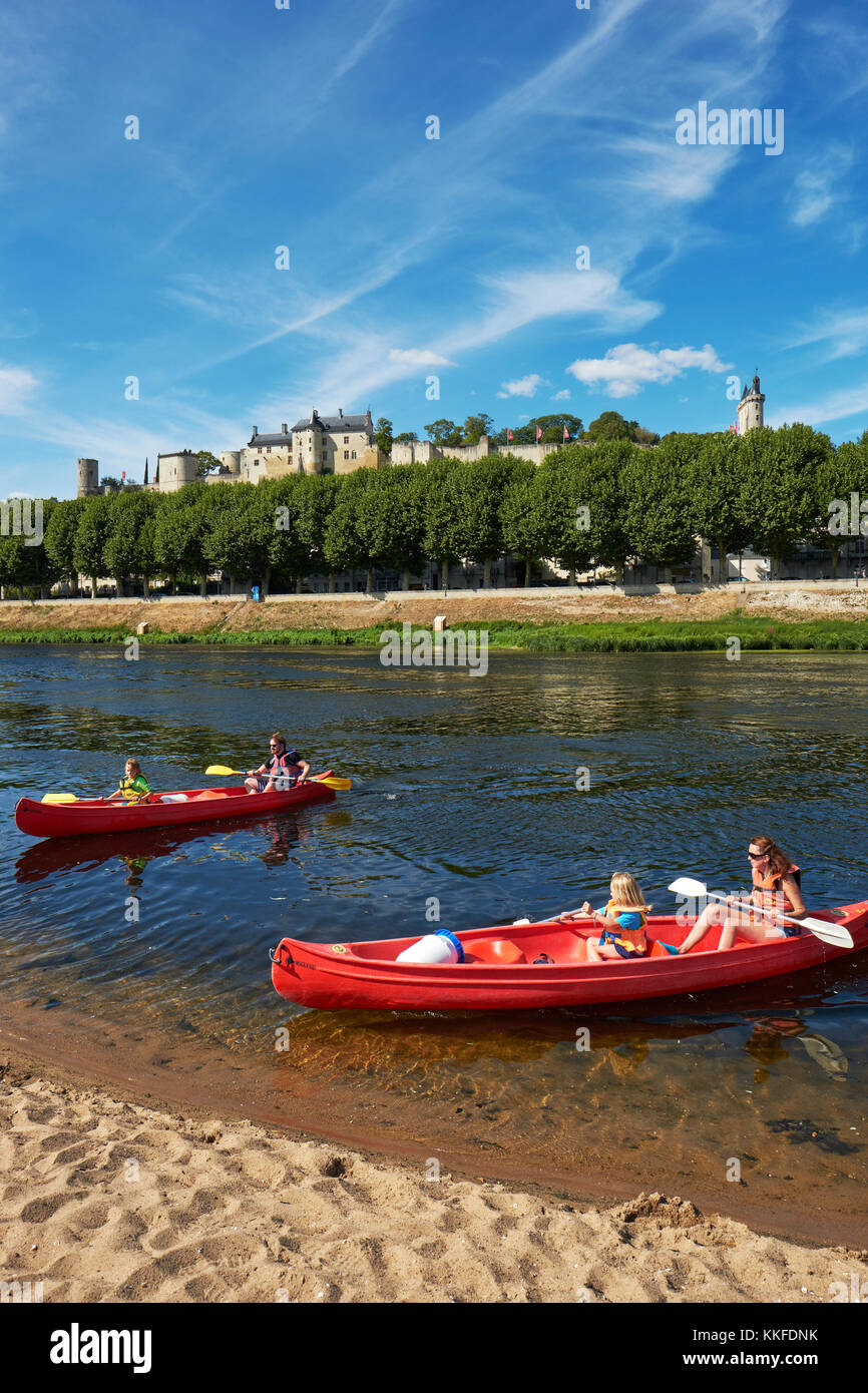 A family canoeing the historic UNESCO world heritage site of Chinon on the Vienne River in the Loire Valley, Indre - Stock Image