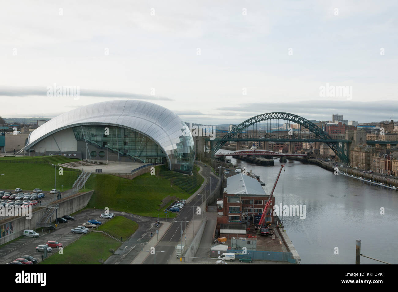 Looking to the Sage in Gateshead, from the viewing room in the Baltic and the River Tyne bridges in the background Stock Photo