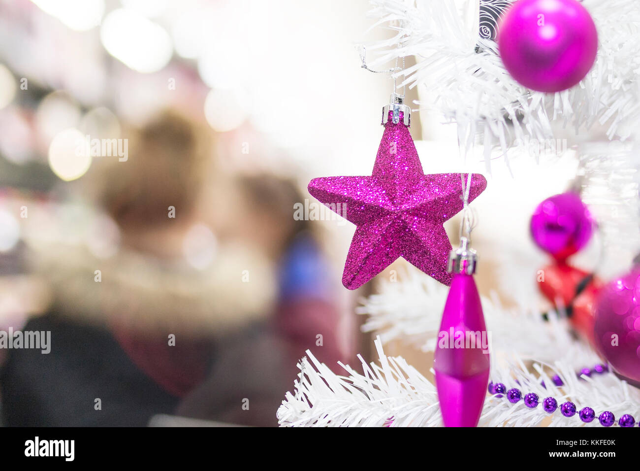Purple Star Baubles And Decorations Hanging On A White Christmas