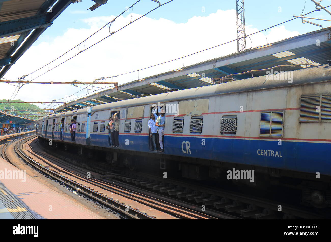 People travel by City train in downtown Mumbai India. Stock Photo