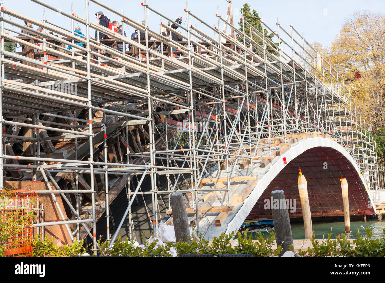 Accademia Bridge covered in scaffolding, Grand Canal, Venice, Italy during renovations funded by Luxottica - Stock Image