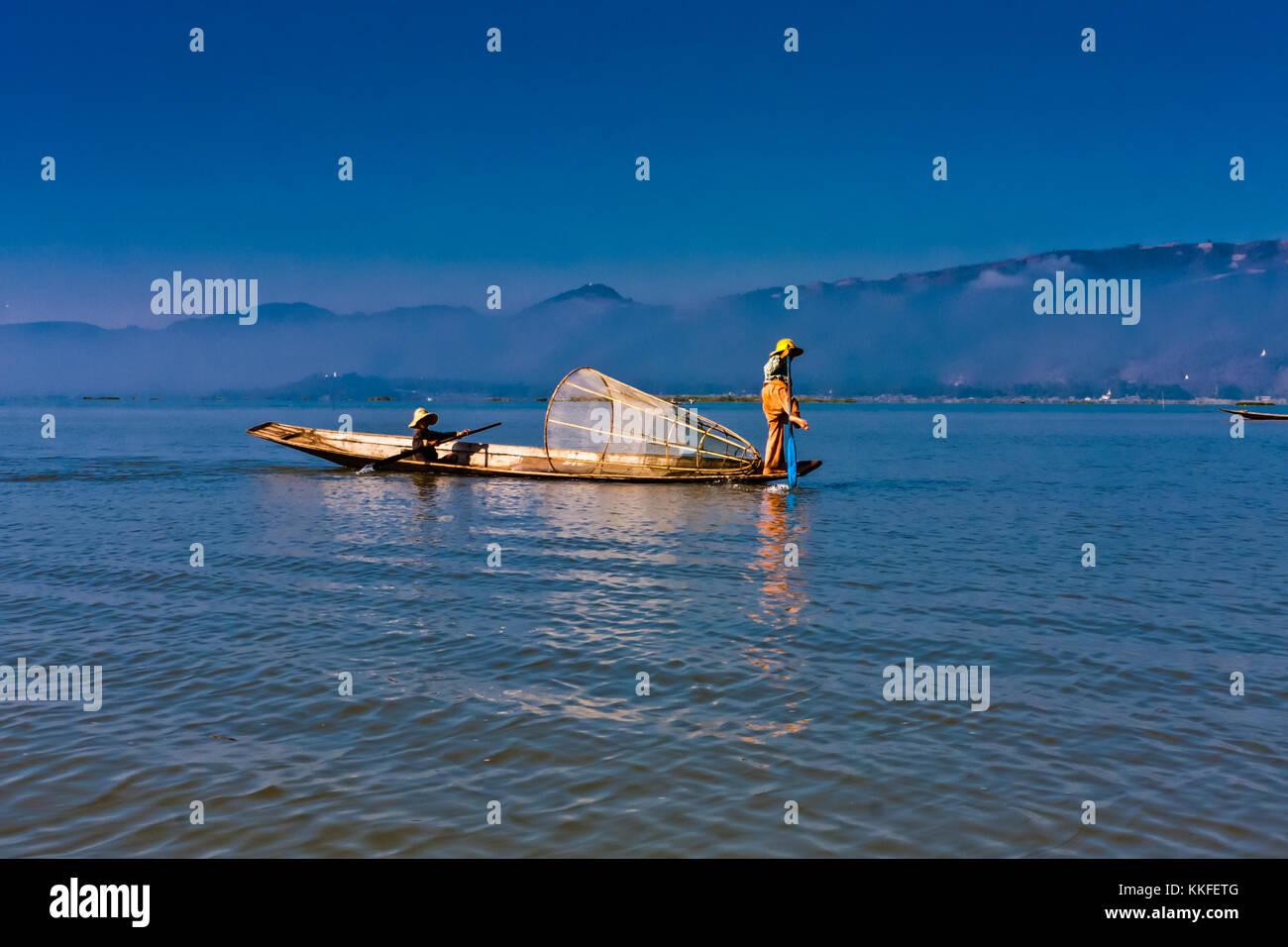 Iconic fishermen on the Inle Lake, Taunggyi, Myanmar Stock Photo