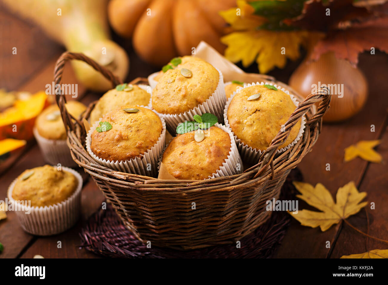 Appetizing and ruddy muffins with pumpkin and walnut. Stock Photo