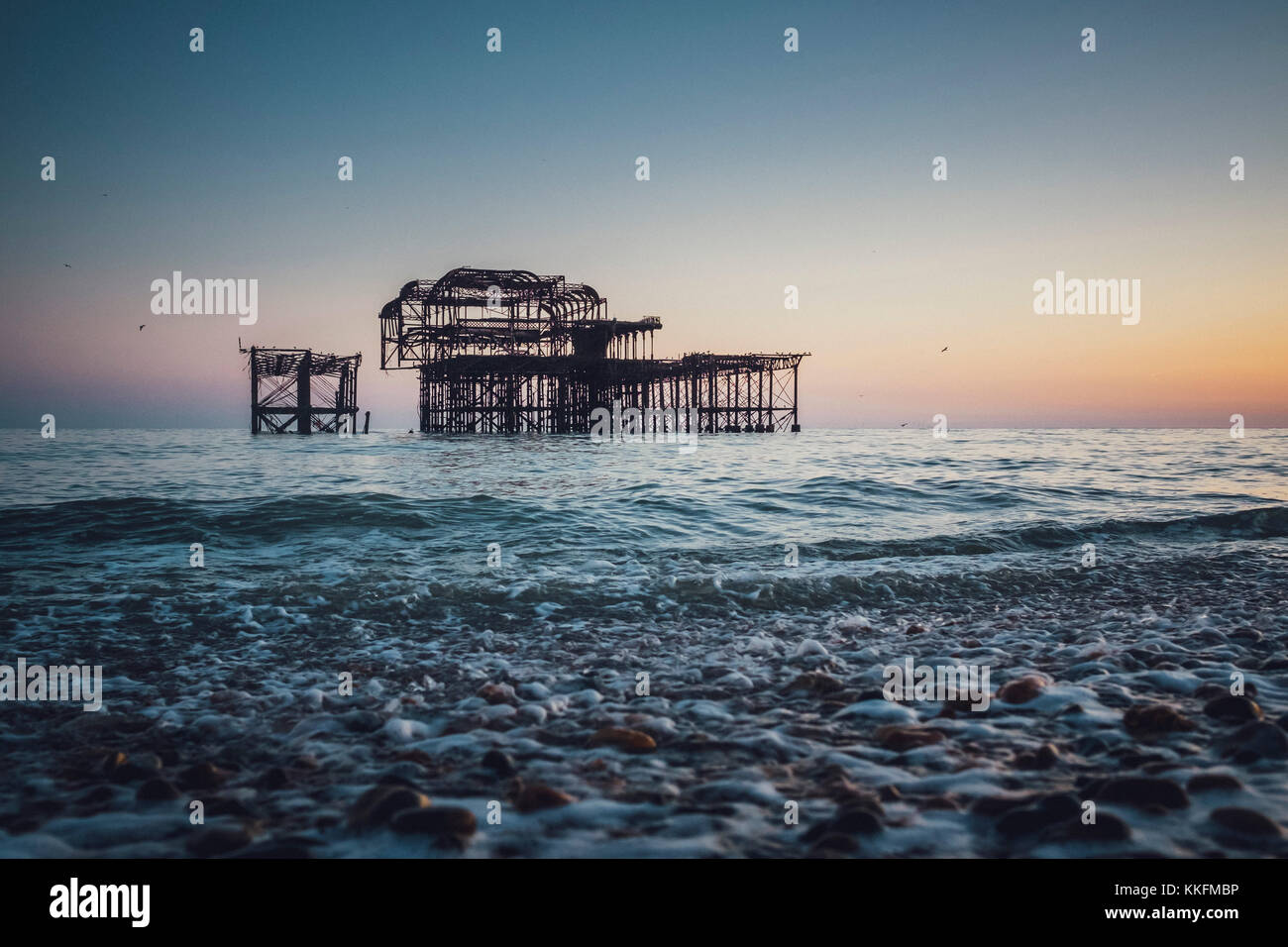 Burnt West Pier at dusk, Brighton, England - Stock Image