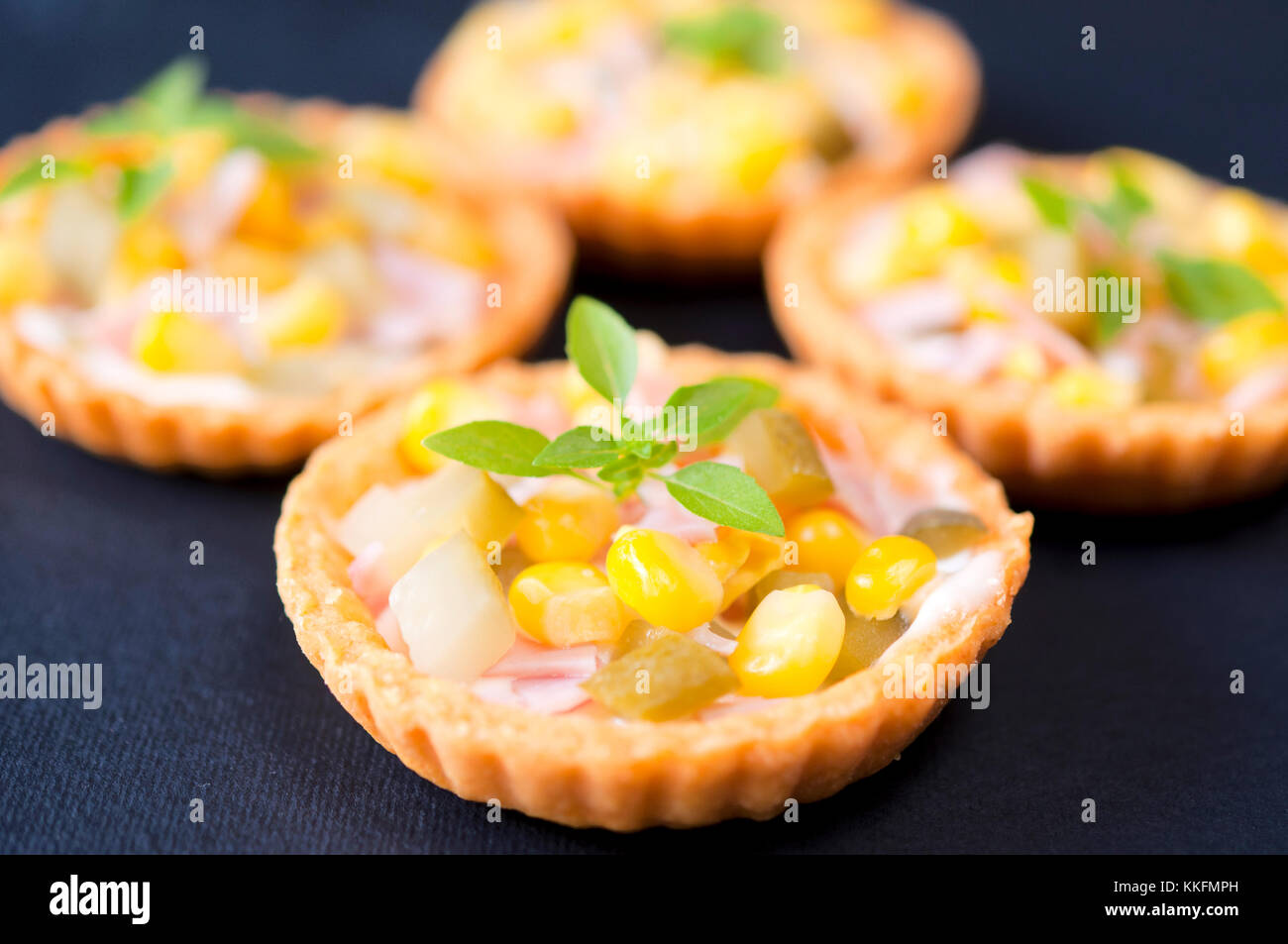 Corn and ham with mayonnaise in small pastry cup - Stock Image
