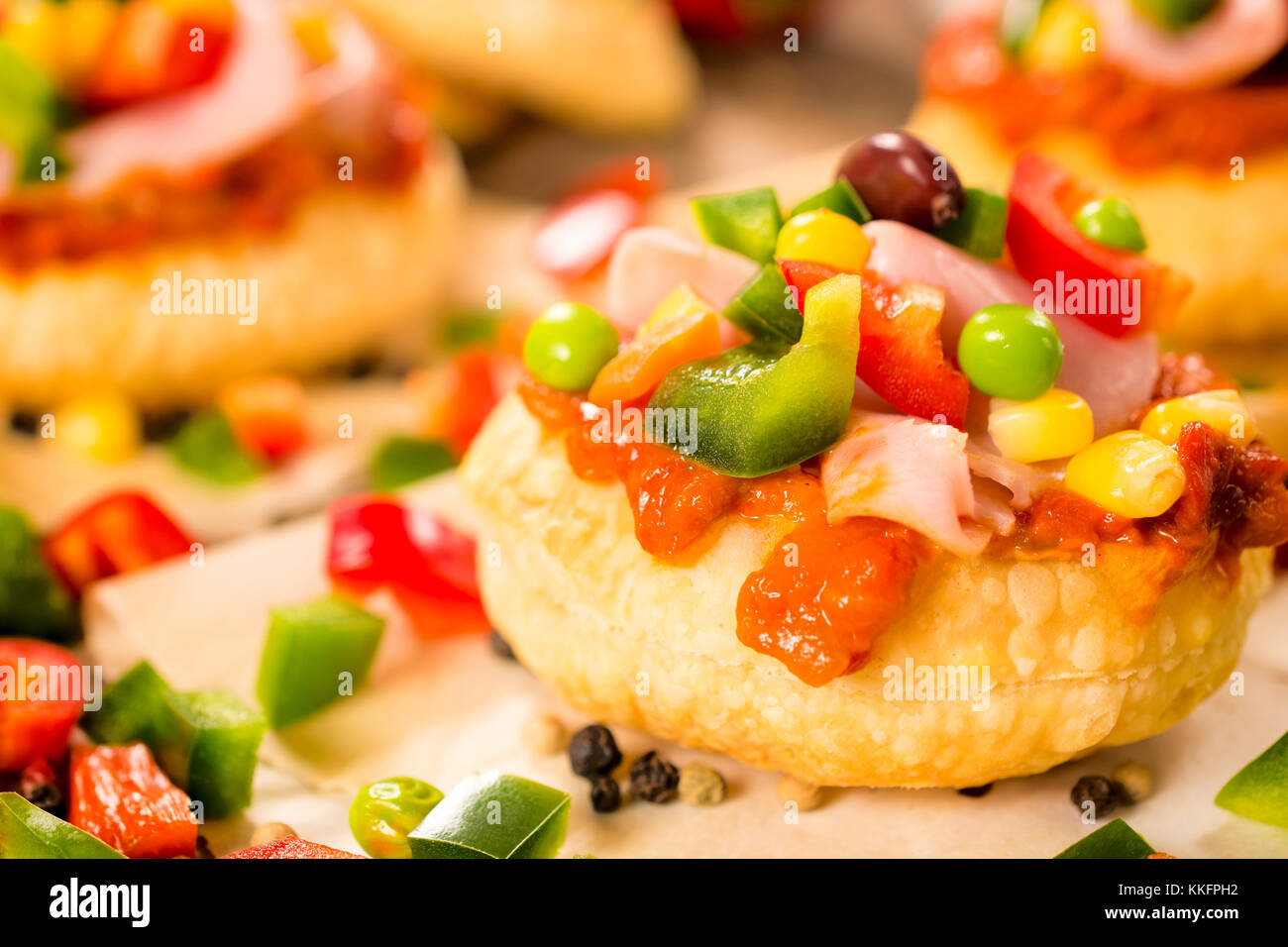Mini ajvar sandwiche with vegetables and ham - Stock Image