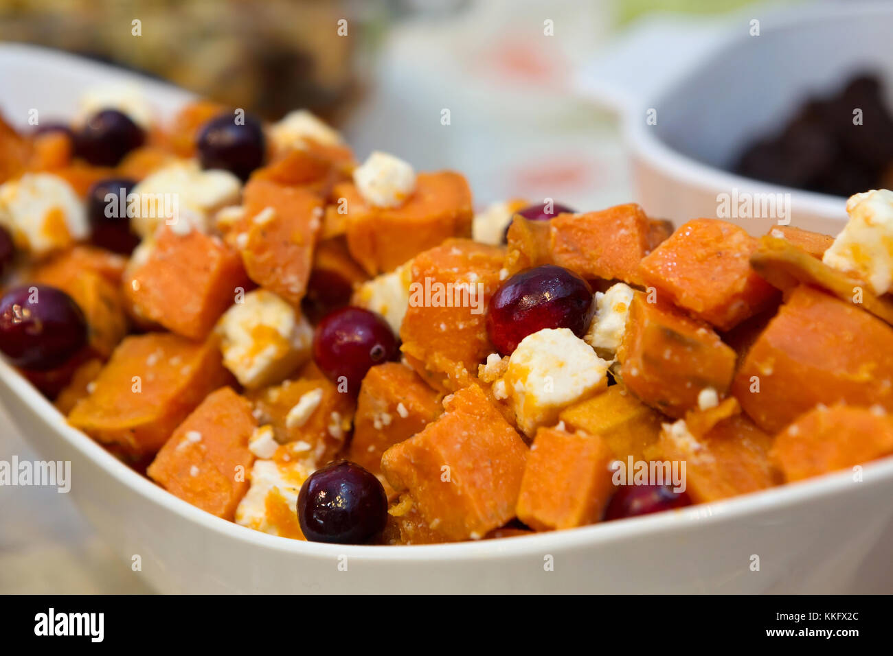 Tasty Sweet Potato Appetizer Dish with Cranberries and Feta Stock Photo