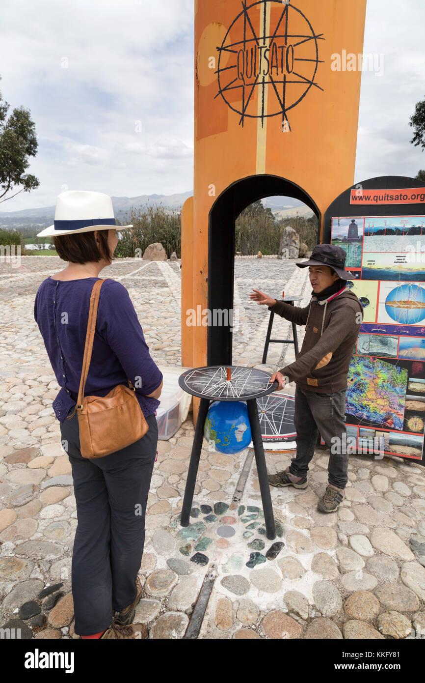 Ecuador tourism - a tourist at the Ecuador Equator monument - The Quitsato Sundial on the equator at Cayambe, Ecuador, - Stock Image