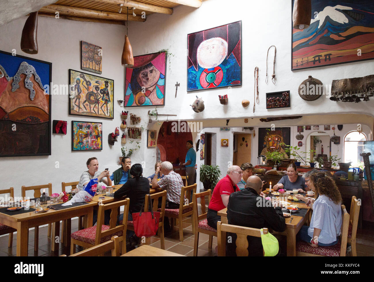 Ecuador hotel interior - hotel guests having a meal in the restaurant, Hosteria Pantavi, Otavalo, Ecuador South - Stock Image