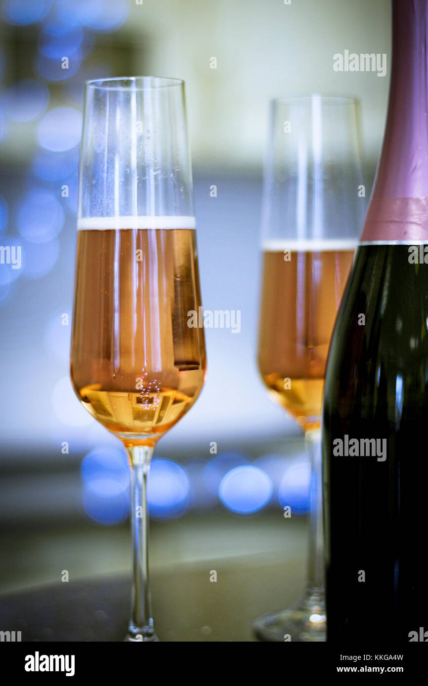 Two filled glasses and a bottle - Stock Image
