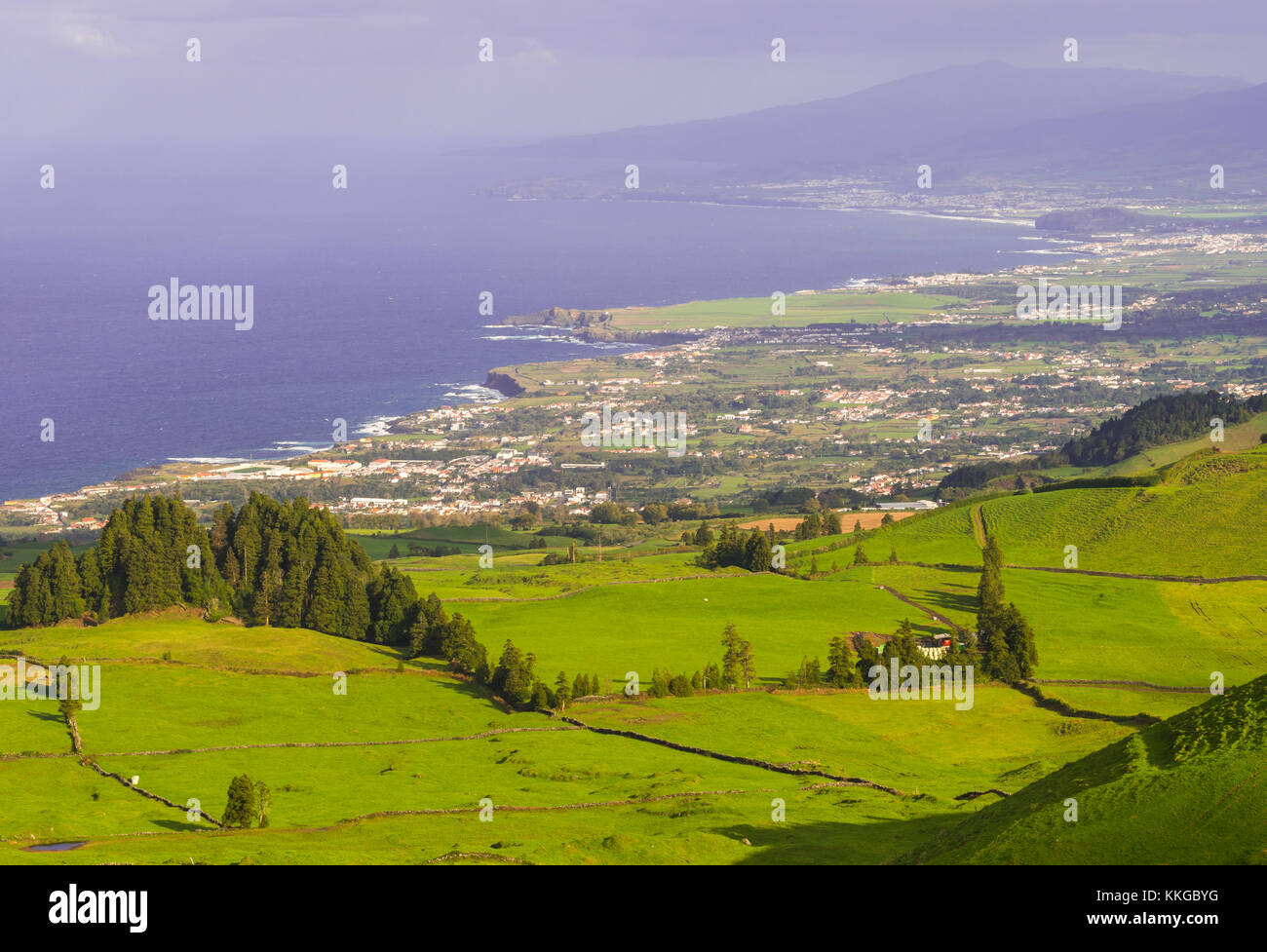 Landscape in Sao Miguel Island, Azores, Portugal, as seen from Coal Peak viewpoint. Capelas in the background - Stock Image