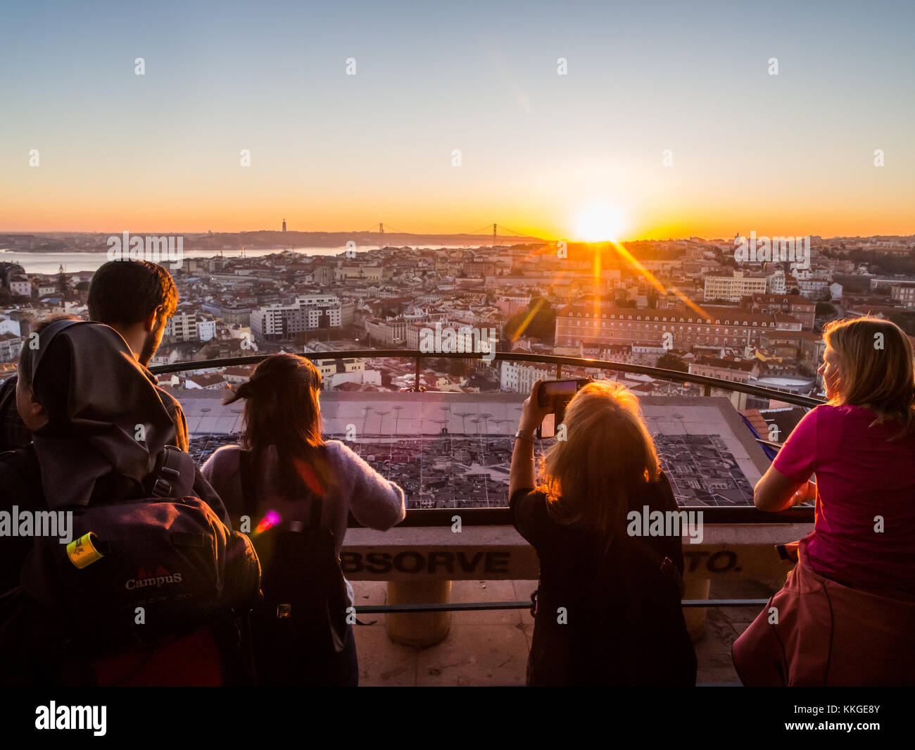 LISBON, PORTUGAL - NOVEMBER 19, 2017: Tourists at Belvedere of Our Lady of the Hill viewpoint, looking at the cityscape - Stock Image