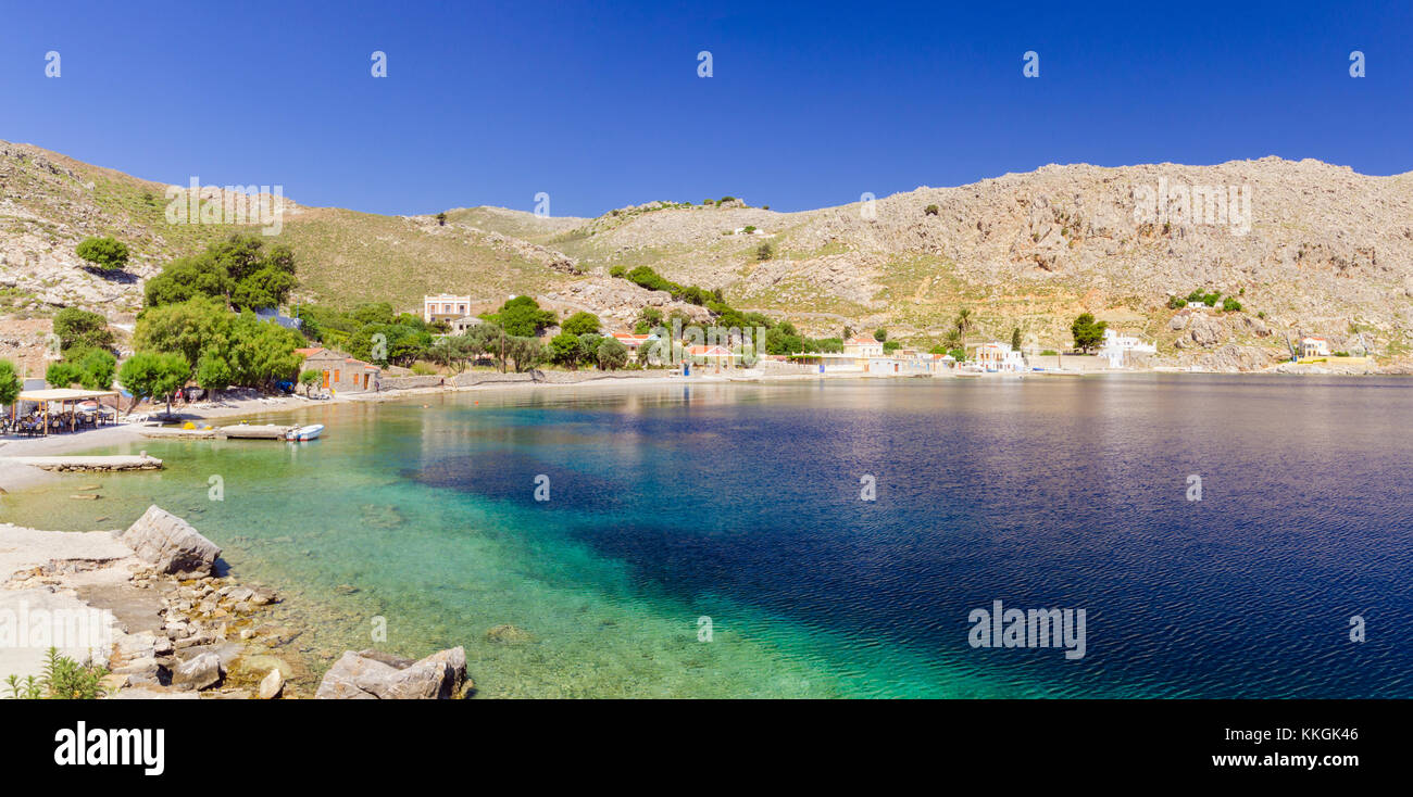 Panorama of the peaceful village of Emporios on Symi Island, Dodecanese, Greece - Stock Image
