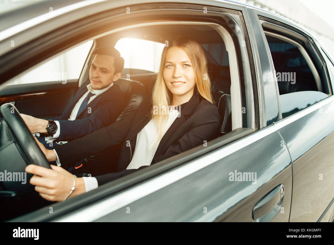 Driving School - woman steer car with steering wheel, maybe she has driving test - Stock Image