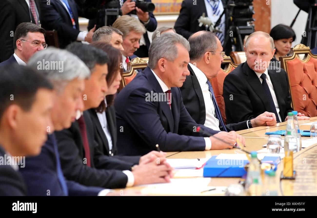 Minsk, Belarus. 30th Nov, 2017. Russian President Vladimir Putin chats with Foreign Minister Sergei Lavrov, left, - Stock Image