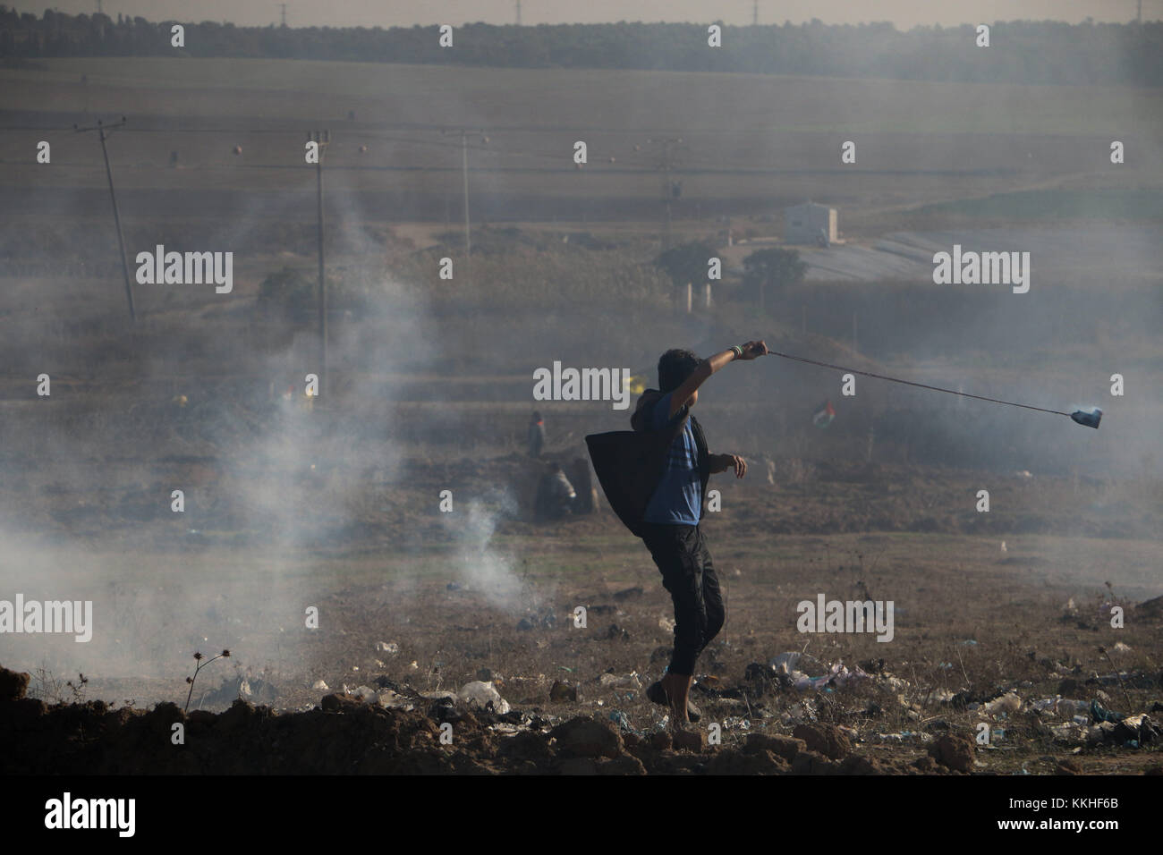 Gaza Strip border with Israel. 1st Dec, 2017. Clashes erupt between young Palestinians and Israeli soldiers on the - Stock Image