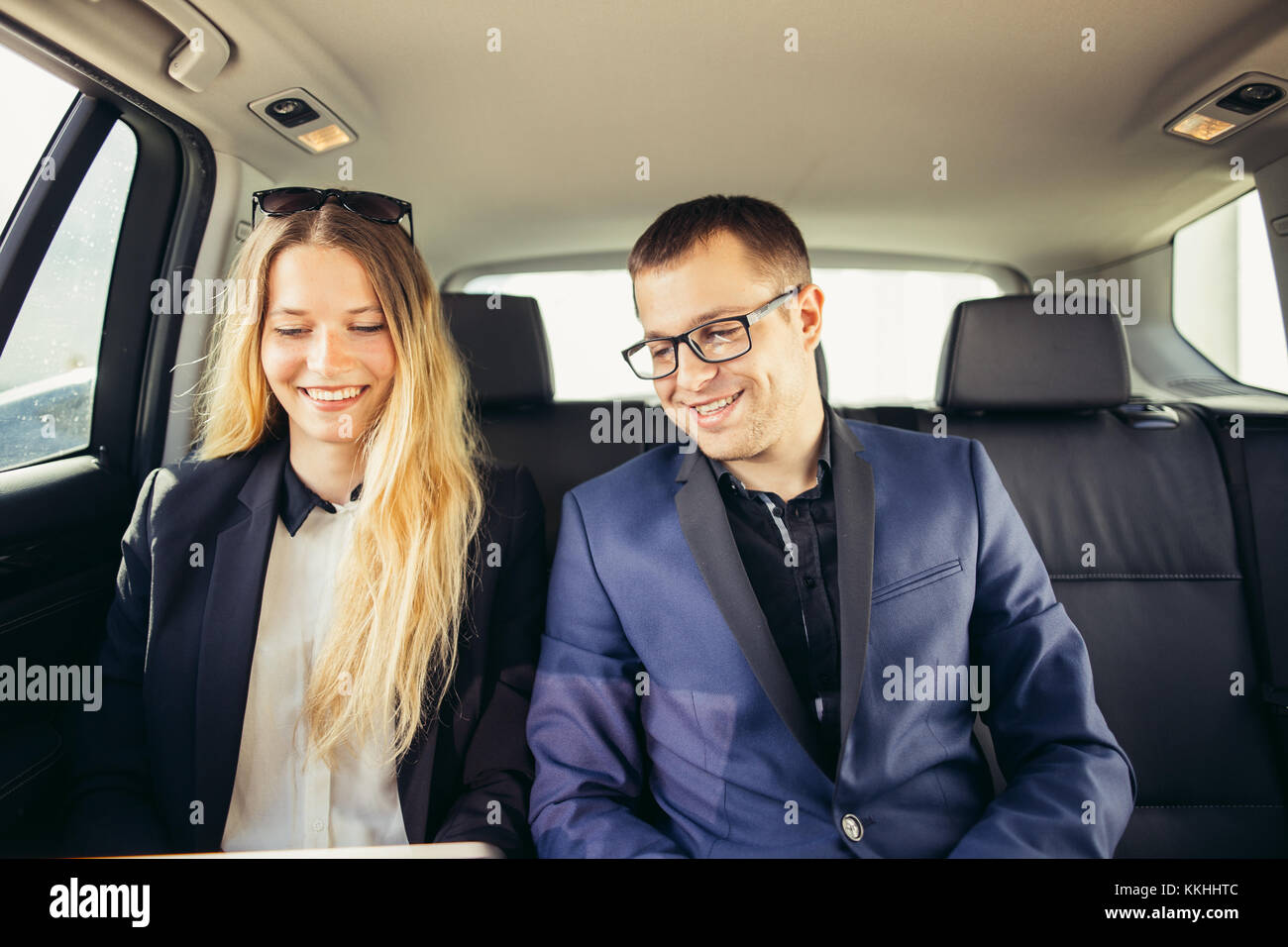 Business People Meeting Working Car Inside - Stock Image