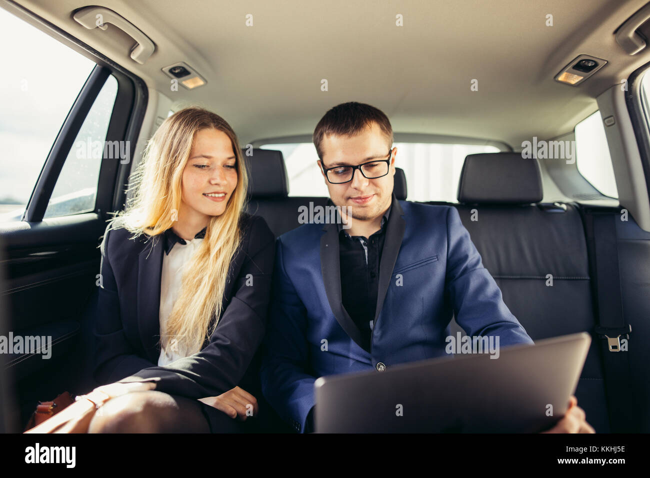 Business People Meeting Working Car Inside Stock Photo